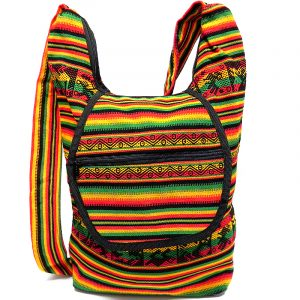 Large crossbody hobo purse bag with tribal print striped pattern material (or manta Inca), vegan leather base, and outer flap pocket in Rasta colors.