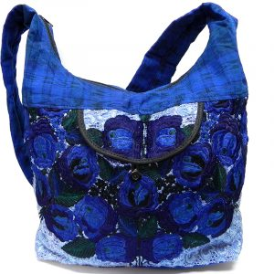 Handmade large floral purse bag with embroidered cotton, plaid fabric, zipper closure, outer pocket, and strap in blue color combination.