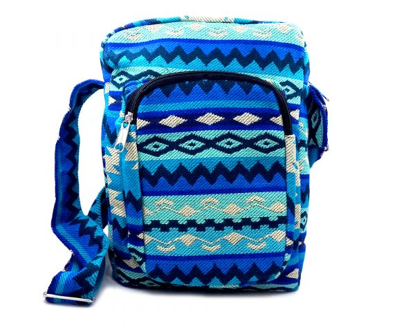 Handmade large cushioned rectangle-shaped crossbody travel purse bag with Aztec inspired tribal print pattern material and large pocket in blue, mint aqua, turquoise, beige, and navy blue color combination.