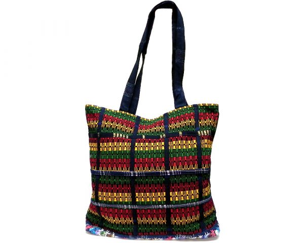 Extra large woven cotton tote purse bag with multicolored stripes, denim material, and floral embroidered base in Rasta colors.