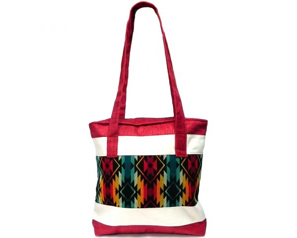 Handmade large slightly cushioned tote purse bag with Aztec inspired tribal print striped pattern material, off-white fabric, and vegan suede in red and southwest multicolored color combination.