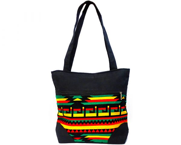 Extra large slightly cushioned tote purse bag with Aztec inspired tribal print striped pattern material and vegan suede in Rasta colors.
