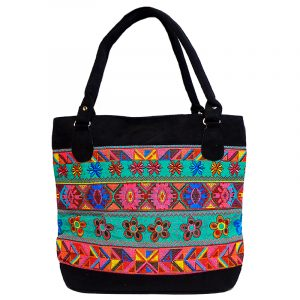 Handmade large tote purse bag with multicolored huipil embroidered floral tribal pattern design and black vegan leather suede in teal green color.