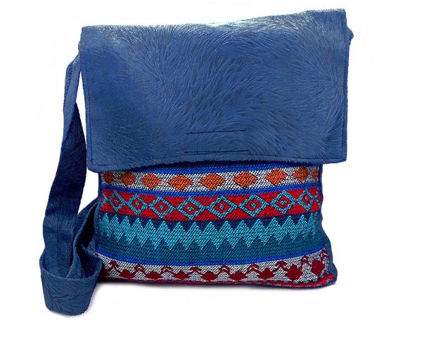 Handmade large cushioned crossbody messenger purse bag with Aztec inspired tribal print striped pattern material and vegan suede in navy blue, teal green, red, gray, and orange color combination.