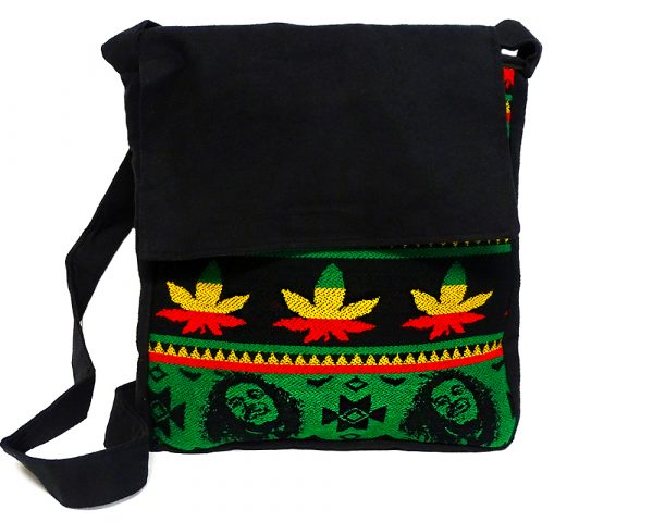 Large cushioned crossbody messenger purse bag with Aztec inspired tribal print striped pattern material and vegan suede in Rasta colors.