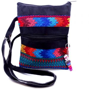 Medium-sized slim rectangle-shaped crossbody purse bag with multicolored huipil embroidered tribal pattern design, black vegan leather suede, and worry doll keychain.