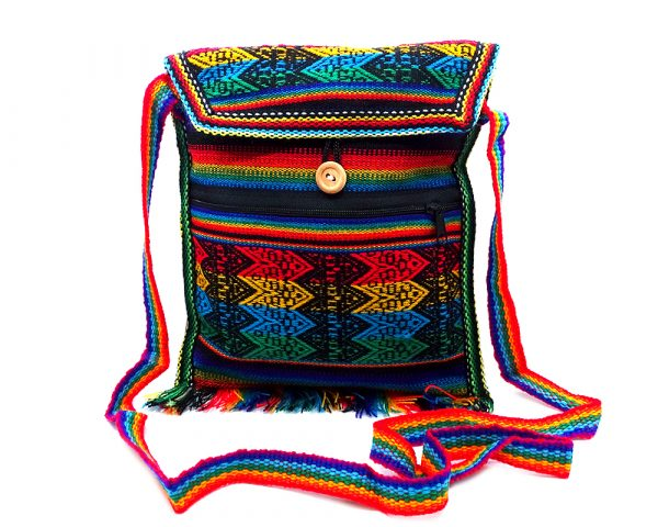 Medium-sized slim square-shaped purse bag with multicolored tribal print pattern material (or manta Inca) and fringe in rainbow colors.