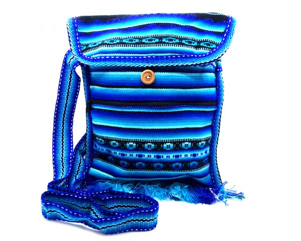 Handmade medium-sized slim square-shaped purse bag with multicolored tribal print striped pattern material (or manta Inca) and fringe in blue, turquoise, light blue, and black color combination.