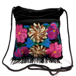 Medium-sized slim square-shaped purse bag with multicolored embroidered floral designs, black velvet cotton material, and fringe.