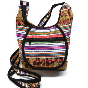 Handmade medium-sized crossbody purse bag with tribal print striped pattern material (or manta Inca), vegan leather base, and outer flap pocket in white, tan, brown, dark red, and multicolored color combination.