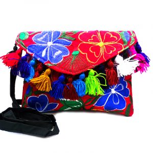 Handmade slim envelope purse bag with floral embroidered cotton material, pom pom fringe, magnetic snap closure, and a crossbody strap in red and multicolored color combination.