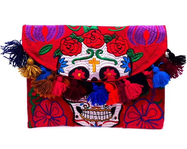 Handmade Day of the Dead sugar skull purse with embroidered floral design, cotton pom poms, and crossbody strap in red and multicolored medium size.