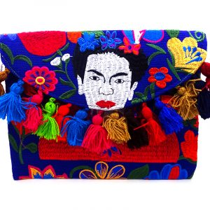 Handmade Frida Kahlo purse bag with floral embroidered cotton material, pom pom fringe, magnetic snap closure, and a crossbody strap in blue and multicolored color combination.