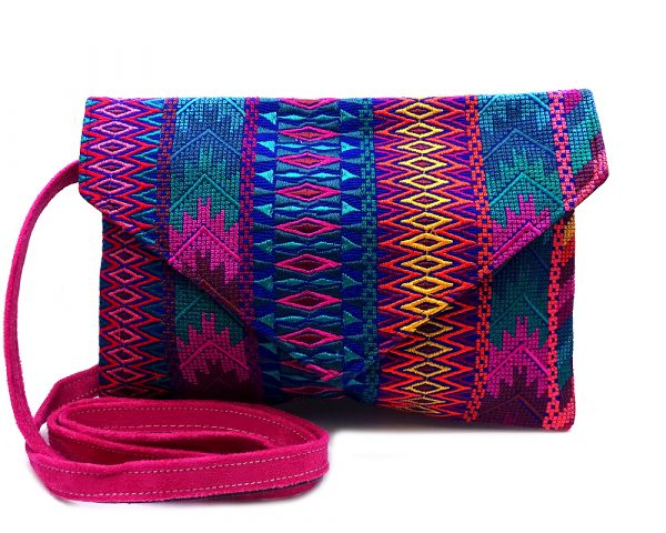 Handmade slim envelope purse bag with tribal huipil embroidered cotton material, magnetic snap closure, and a crossbody strap in blue, hot pink, and multicolored color combination.