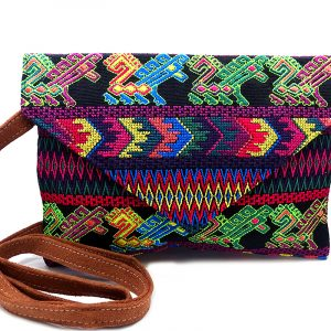 Handmade slim envelope purse bag with floral tribal huipil embroidered cotton material, magnetic snap closure, and a crossbody strap in black and neon multicolored color combination.