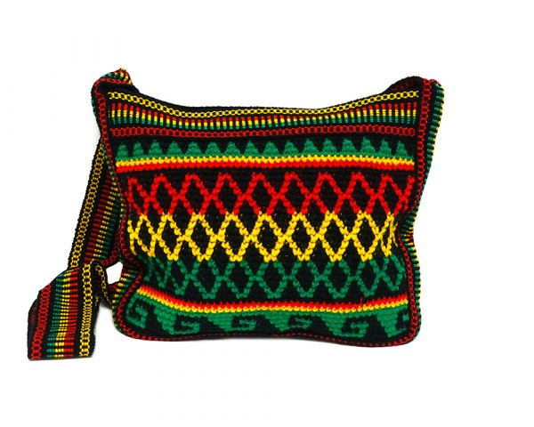 Medium-sized thick rectangle-shaped crochet purse bag with tribal pattern criss cross design in Rasta colors.
