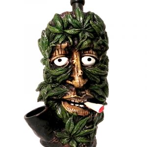 Handcrafted medium-sized tobacco smoking hand pipe of a smoking tree man face covered with multiple green leaves.