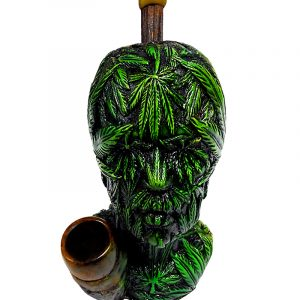 Handcrafted medium-sized tobacco smoking hand pipe of a head covered with multiple green hemp leaves.