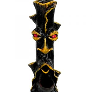 Handcrafted medium-sized tobacco smoking hand pipe of a brown tree stump man face with red eyes.