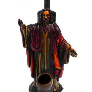 Handcrafted medium-sized tobacco smoking hand pipe of Jesus Christ wearing red and brown robes and holding up a peace sign.