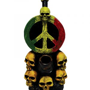 Handcrafted medium-sized tobacco smoking hand pipe of a peace sign symbol in Rasta colors with a pile of skulls.