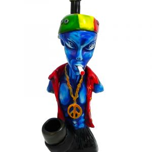 Handcrafted medium-sized tobacco smoking hand pipe of a smoking blue alien with a Rasta hat and peace sign chain.