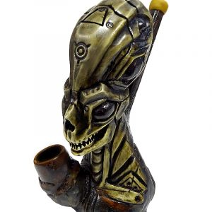 Handcrafted medium-sized tobacco smoking hand pipe of a gray alien head.