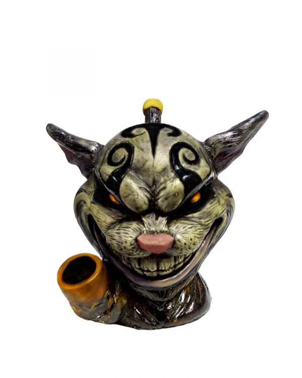 Handcrafted medium-sized tobacco smoking hand pipe of an evil Cheshire cat head.