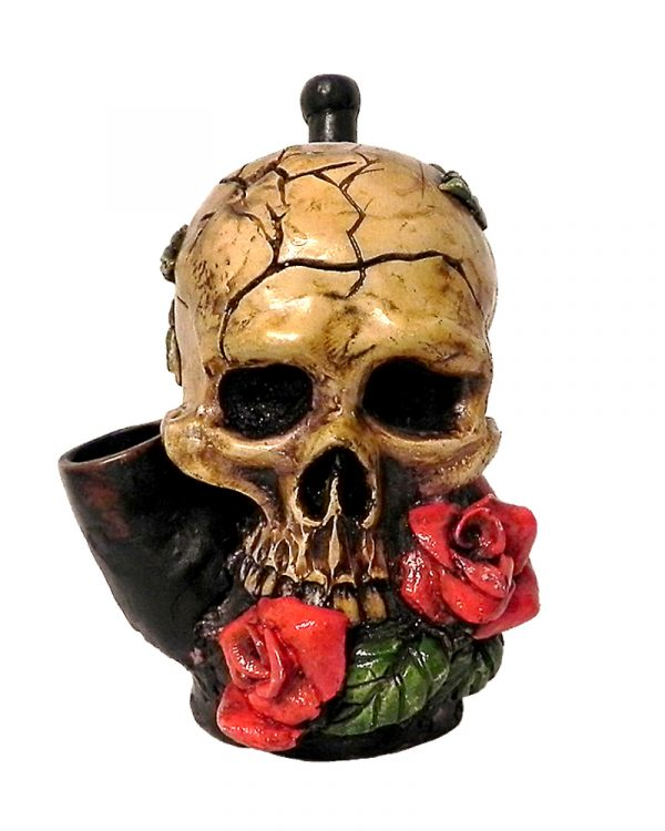 Handcrafted medium-sized tobacco smoking hand pipe of a skull with red roses in its mouth.