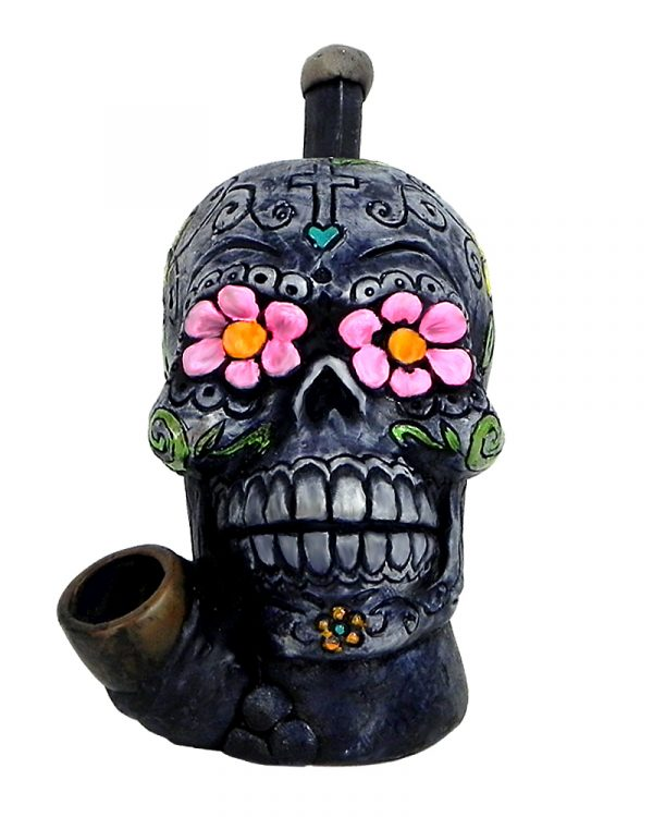 Handcrafted medium-sized tobacco smoking hand pipe of a gray Day of the Dead sugar skull with multicolored floral designs.