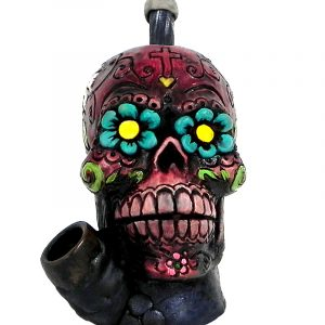 Handcrafted medium-sized tobacco smoking hand pipe of a red Day of the Dead sugar skull with multicolored floral designs.