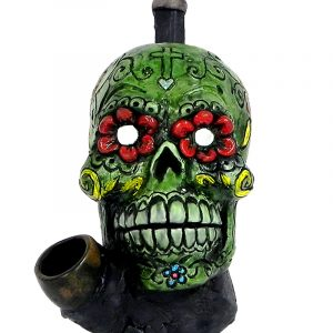 Handcrafted medium-sized tobacco smoking hand pipe of a green Day of the Dead sugar skull with multicolored floral designs.