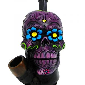 Handcrafted medium-sized tobacco smoking hand pipe of a purple Day of the Dead sugar skull with multicolored floral designs.