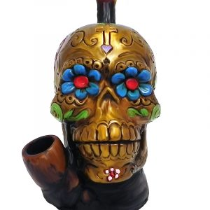 Handcrafted medium-sized tobacco smoking hand pipe of a gold Day of the Dead sugar skull with multicolored floral designs.