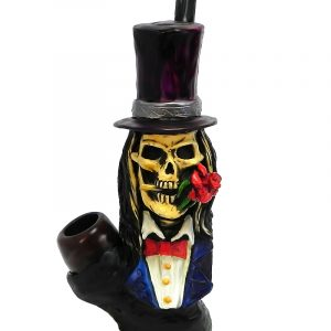 Handcrafted medium-sized tobacco smoking hand pipe of a skull with a top hat, tuxedo suit, and a red rose in its mouth.