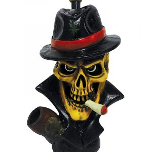 Handcrafted medium-sized tobacco smoking hand pipe of a smoking mobster skull with a hat.