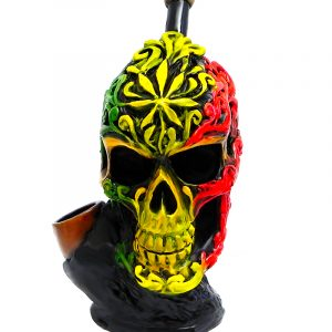 Handcrafted medium-sized tobacco smoking hand pipe of a skull with tribal designs in Rasta colors.