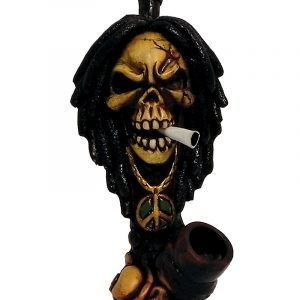 Handcrafted medium-sized tobacco smoking hand pipe of a smoking angry skull with dreads and a peace sign chain.