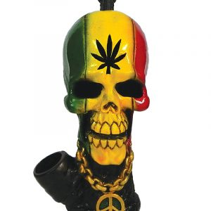 Handcrafted medium-sized tobacco smoking hand pipe of a skull with a hemp leaf on its forehead and a peace sign chain in Rasta colors.