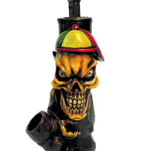 Handcrafted medium-sized tobacco smoking hand pipe of a skull with a hat in Rasta colors and a hemp leaf tattoo.