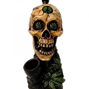 Handcrafted medium-sized tobacco smoking hand pipe of a skull with hemp leaf eyes and a green peace sign on its forehead.