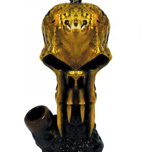 Handcrafted medium sized hand pipe of a gold skull with fangs.