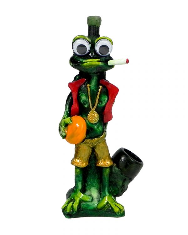 """Handcrafted medium-sized tobacco smoking hand pipe of a smoking green """"chill"""" frog with a gold peace sign chain, ball, and googly eyes in Rasta colors."""