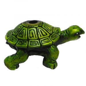 Handcrafted medium sized hand pipe of a green turtle with geometric tribal design.