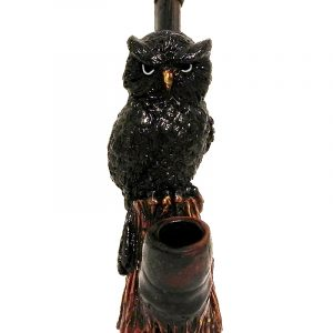 Handcrafted medium-sized tobacco smoking hand pipe of a black owl bird.