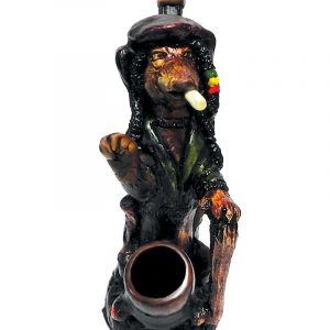 Handcrafted medium-sized tobacco smoking hand pipe of a smoking dog with dreads and a wooden cane in Rasta colors.
