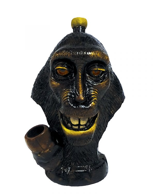 Handcrafted medium-sized tobacco smoking hand pipe of a famous smiling selfie monkey face.