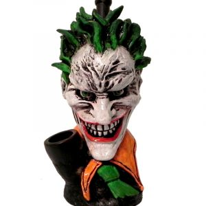 Handcrafted medium-sized tobacco smoking hand pipe of an evil clown character with a big head, creepy smile, green hair, and suit.