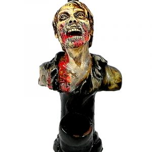 Handcrafted medium-sized tobacco smoking hand pipe of a hungry zombie head looking up.