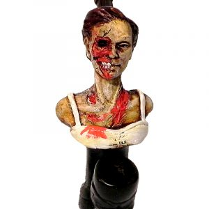 Handcrafted medium-sized tobacco smoking hand pipe of a female zombie head with one eye.